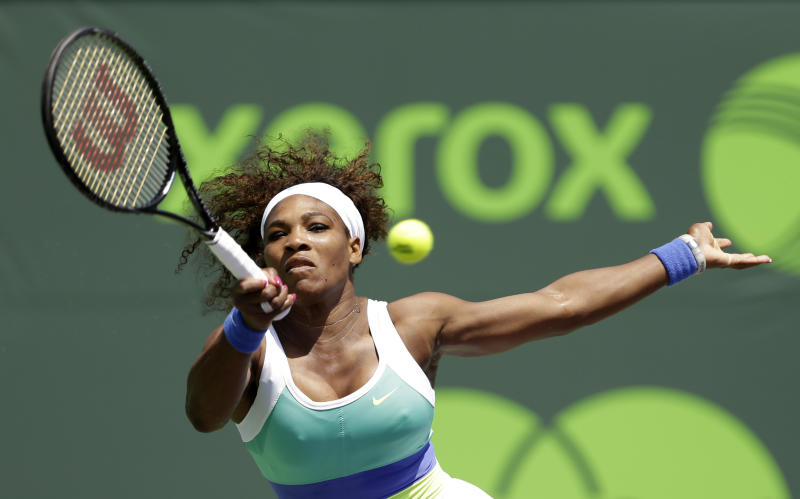 Serena Williams, of the United States, returns to Li Na, of China, during the Sony Open tennis tournament in Key Biscayne, Fla.,  Tuesday, March 26, 2013. (AP Photo/Alan Diaz)