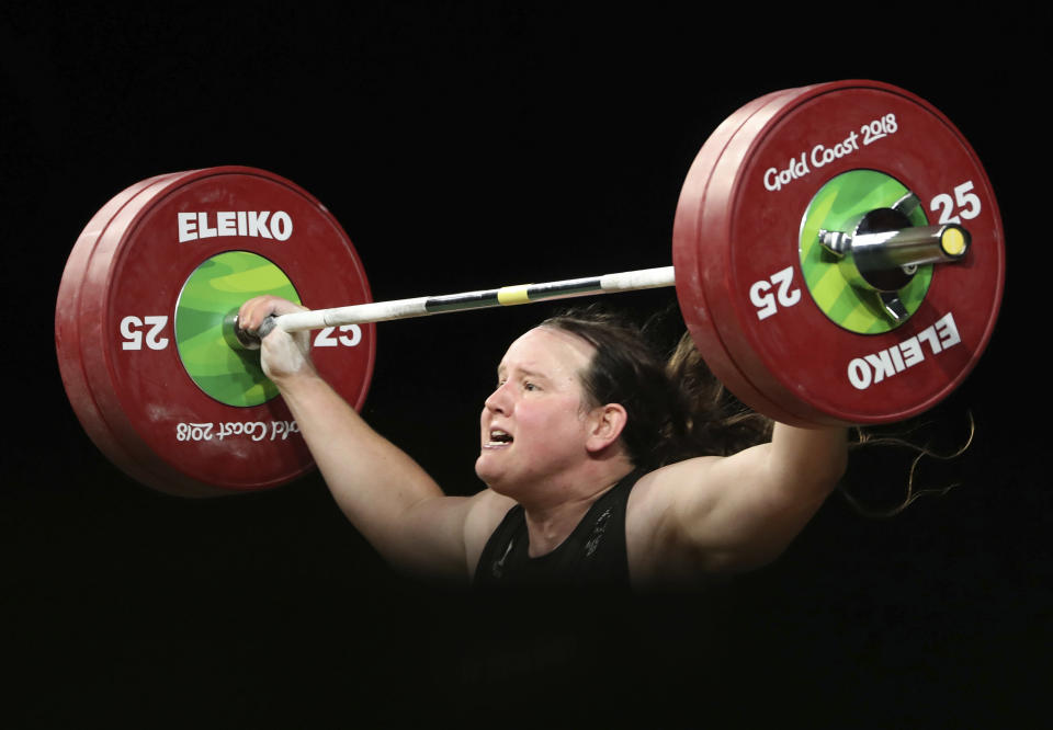 FILE - In this April 9, 2018 file photo, New Zealand's Laurel Hubbard lifts in the snatch of the women's +90kg weightlifting final at the 2018 Commonwealth Games on the Gold Coast, Australia. Hubbard will be the first transgender athlete to compete at the Olympics.Hubbard is among five athletes confirmed on New Zealand's weightlifting team for the Tokyo Games. (AP Photo/Mark Schiefelbein,File)