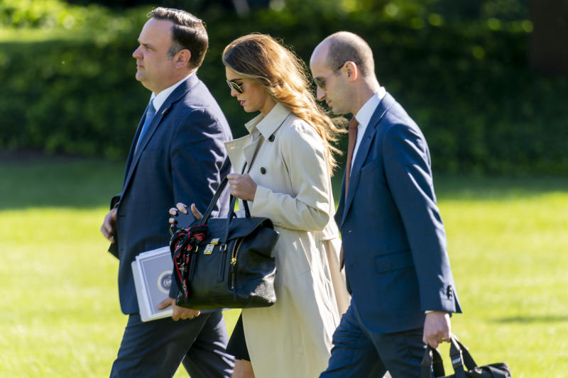 From left, White House Social Media Director Dan Scavino, Counselor to the President Hope Hicks, and President Donald Trump's White House senior adviser Stephen Miller, walk across the South Lawn to board Marine One on the South Lawn of the White House in Washington, Monday, Sept. 21, 2020. All three tested positive for COVID-19. (Andrew Harnik/AP)