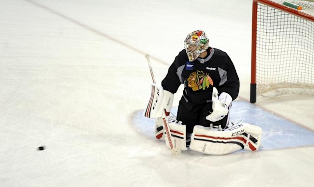 Chicago Blackhawks' goaltender Nikolai Khabibulin, of Russia, makes a save during a drill at NHL hockey training camp on the campus of the University of Notre Dame in South Bend, Ind., Thursday, Sept. 12, 2013. (AP Photo/Joe Raymond)