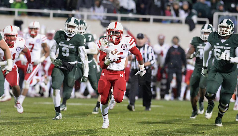 Nebraska's De'Mornay Pierson-El runs back a punt for a touchdown against Michigan State in the fourth quarter Oct. 4, 2014.
