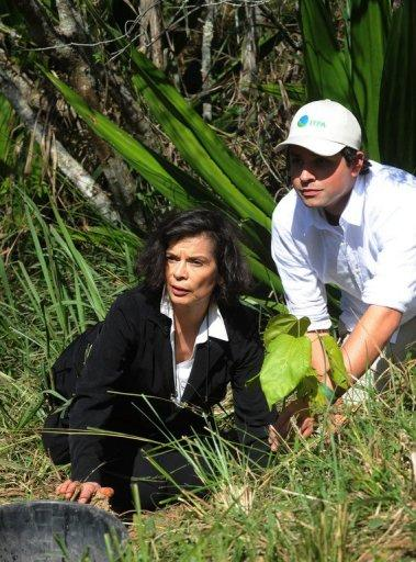 Bianca Jagger (L) plants a King tree beside Terra Institute of Environmental Preservation (IPTA) environmentalist Mauricio Ruiz in the framework of the Rio +20 Environmental Summit. The UN conference, which marks the 20th anniversary of the Earth Summit -- a landmark 1992 gathering that opened the debate on the future of the planet and its resources -- is the largest ever organized