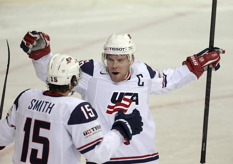 U.S. Paul Stastny, right,  celebrates his second goal of the first period with Craig Smith (15) during the 2013 Ice Hockey IIHF World Championships preliminary round match Russia vs USA in Helsinki, Finland, on Tuesday, May 7, 2013.  (AP Photo / Lehtikuva, Martti Kainulainen)  FINLAND OUT - NO SALES