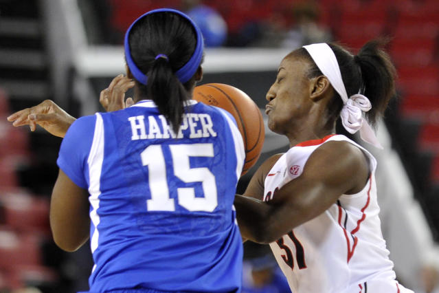 Georgia guard Erika Ford (31) loses control of a ball while defended by Kentucky guard Linnae Harper (15) during the first half of an NCAA college basketball game on Thursday, Jan. 30, 2014, in Athens, Ga. (AP Photo/AJ Reynolds)