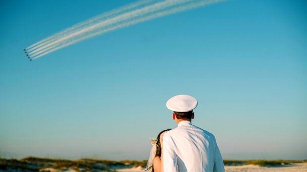 PHOTO: Rachel and Chandler Mills were surprised by a Blue Angels flyover at their wedding in Pensacola, Florida. (Jordan Burch Photography)