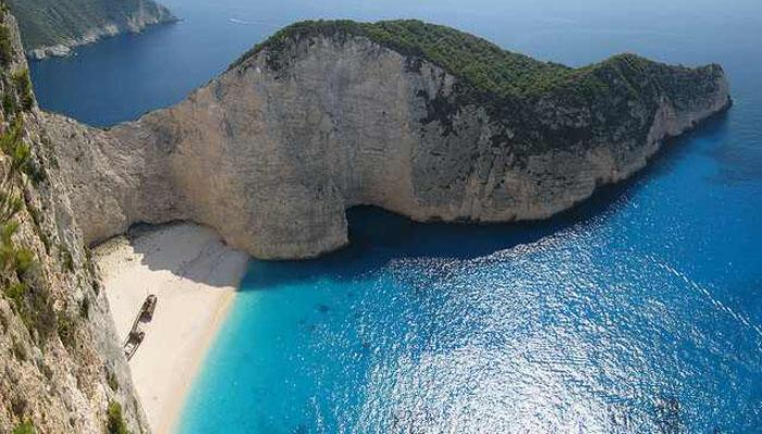 This beautiful sandy cove on Zakynthos Island in Greece is only accessible by boat. It attracts thousands of tourists every year and is well known for its rocky cliffs surrounding the bay from three sides. Fans of this beach remark on the clear blue water and beautiful white sand.