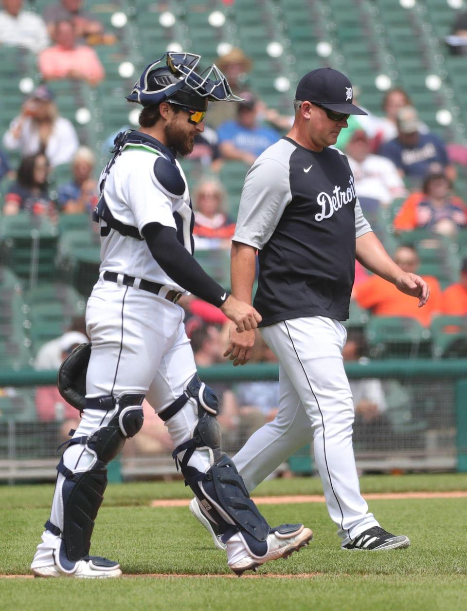 Tigers catcher Eric Haase and manager AJ Hinch walk to the mound during during the sixth inning on Thursday, May 27, 2021, at Comerica Park.