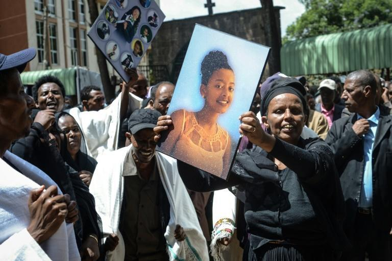 Hundreds gathered for the funerals at Holy Trinity Cathedral in Addis Ababa, weeping and holding up pictures of those who died