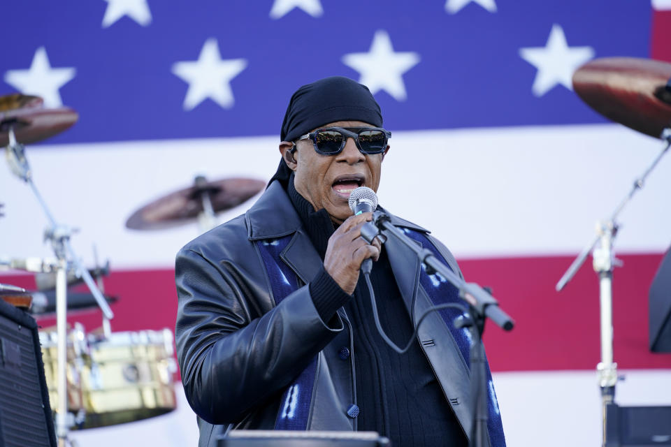 Stevie Wonder speaks before he performs and before Democratic presidential candidate former Vice President Joe Biden and former President Barack Obama speak at a rally at Belle Isle Casino in Detroit, Mich., Saturday, Oct. 31, 2020. (AP Photo/Andrew Harnik)