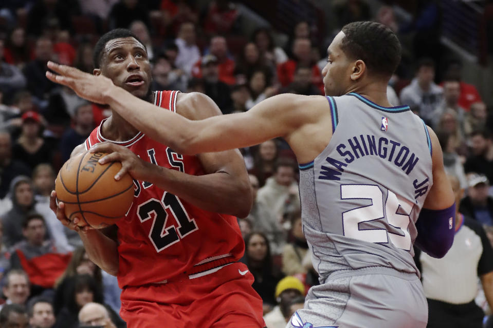Chicago Bulls forward Thaddeus Young, left, drives to the basket as Charlotte Hornets forward P.J. Washington guards during the second half of an NBA basketball game Friday, Dec. 13, 2019, in Chicago. (AP Photo/Nam Y. Huh)