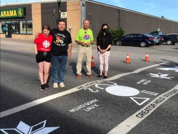 The town of Stephenville has unveiled a new crosswalk adorned with Mi'kmaw symbols and words. The crosswalk is meant to act as a symbol of reconciliation and respect, said mayor Tom Rose. (Town of Stephenville/Facebook - image credit)