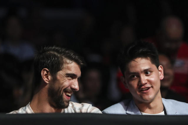 Swim stars Michael Phelps of the United States and Joseph Schooling of Singapore watch the action from cageside. PHOTO: Yong Teck Lim for Yahoo News Singapore
