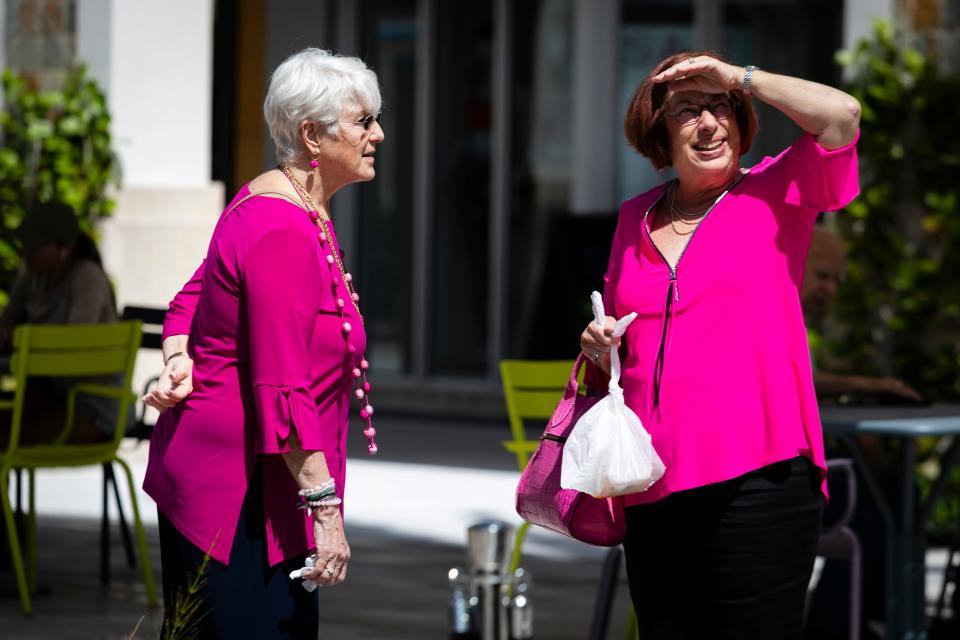"""Senior women walk in a shopping center in West Palm Beach, Florida, on March 12, 2020. - Florida, often called """"the grayest state"""" in the US because so many elderly retire here, is facing up to the fact that it has an alarming concentration of the demographic most at-risk from coronavirus. """"Everything is an uncertainty because we don't know how this is going to end, you know?"""" said Anita Lammersdorf. """"How bad is it going to be?"""" asked the 80-year-old Lithuanian-American who still works as a real estate agent. (Photo by Eva Marie UZCATEGUI / AFP) (Photo by EVA MARIE UZCATEGUI/AFP via Getty Images)"""