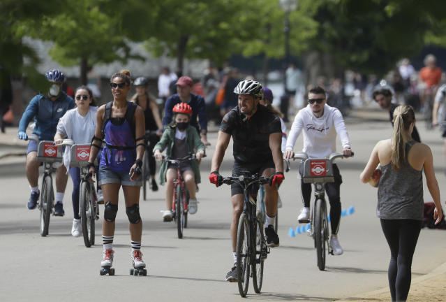 People exercise in Hyde Park after lockdown restrictions were relaxed for England. (AP Photo/Kirsty Wigglesworth)