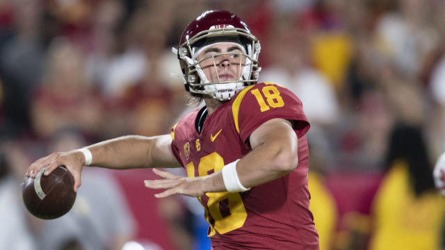 FILE - This Sept. 31, 2019 photo shows Southern California quarterback JT Daniels in an NCAA football game against Fresno State in Los Angeles. Daniels has entered the transfer portal. He announced his plan Thursday, April 16, 2020. Coach Clay Helton says the door is still open for Daniels to stay at USC, where Kedon Slovis took advantage of Daniels' knee injury to become the Trojans' starting quarterback last season. (AP Photo/Kyusung Gong)