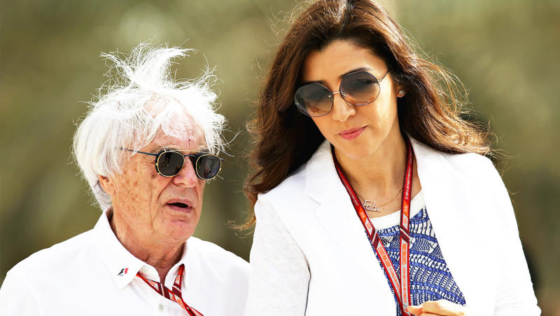 Former F1 boss Bernie Eccleston talks and walks with his wife Fabiana.