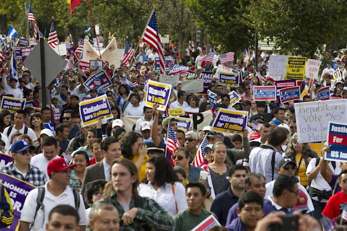 Demonstrators march towards Capitol Hill during a immigration rally and march in Washington, Tuesday, Oct. 8, 2013. ( AP Photo/Jose Luis Magana)