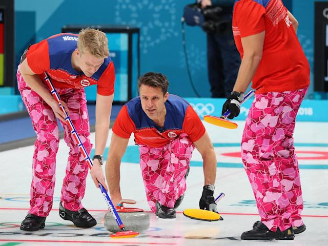 Curlers are a reminder of a more grounded world in which dullness sharpens drama, rather than standing at odds with it: The Asahi Shimbun via Getty Images