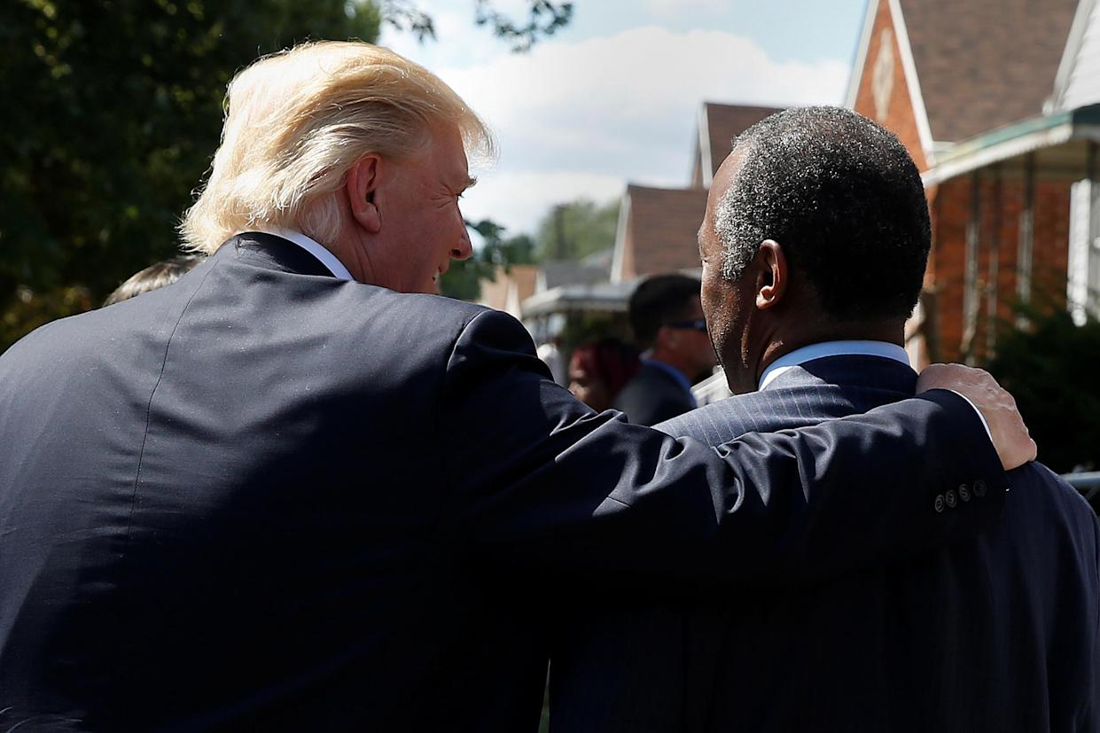 Donald Trump and Ben Carson approach Carson's childhood home in Detroit, Sept. 3, 2016. (Photo: Carlo Allegri/Reuters)