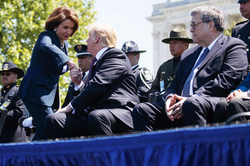 Attorney General William Barr looks on as Trump shakes hands with Pelosi during the 38th Annual National Peace Officers' Memorial Service at the U.S. Capitol on Wednesday, May 15, 2019, in Washington.