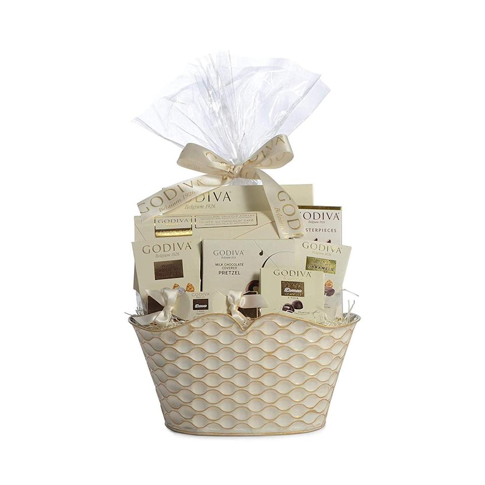<p>If you're feeling fancy, go with this <span>Godiva Chocolatier Gift Basket</span> ($60).</p>