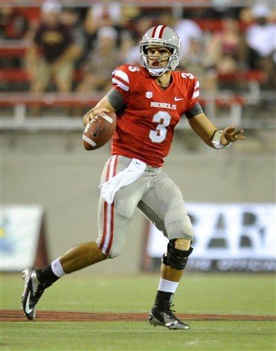 UNLV's quarterback Nick Sherry (3) scrambles during first half action at his NCAA college football game and Minnesota at Sam Boyd Stadium, Thursday, Aug. 30, 2012 in Las Vegas. (AP Photo/David Becker)