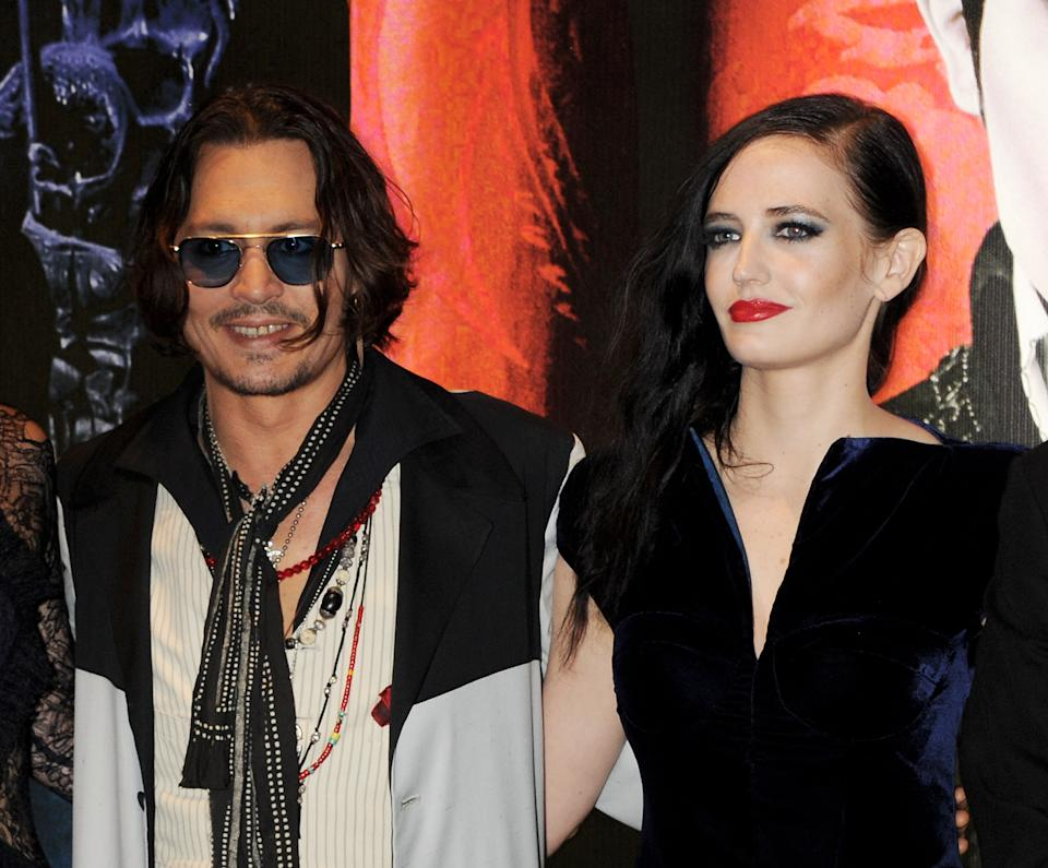 LONDON, ENGLAND - MAY 09:  (EMBARGOED FOR PUBLICATION IN UK TABLOID NEWSPAPERS UNTIL 48 HOURS AFTER CREATE DATE AND TIME. MANDATORY CREDIT PHOTO BY DAVE M. BENETT/GETTY IMAGES REQUIRED)  Actors Johnny Depp (L) and Eva Green attend the European Premiere of 'Dark Shadows' at Empire Leicester Square on May 9, 2012 in London, England.  (Photo by Dave M. Benett/Getty Images)