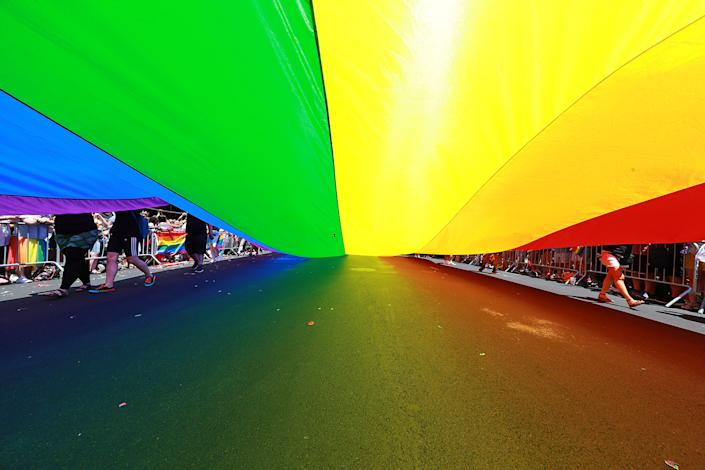 The rainbow color flag is draped over 5th Ave. during the N.Y.C. Pride Parade in New York on June 30, 2019. (Photo: Gordon Donovan/Yahoo News)