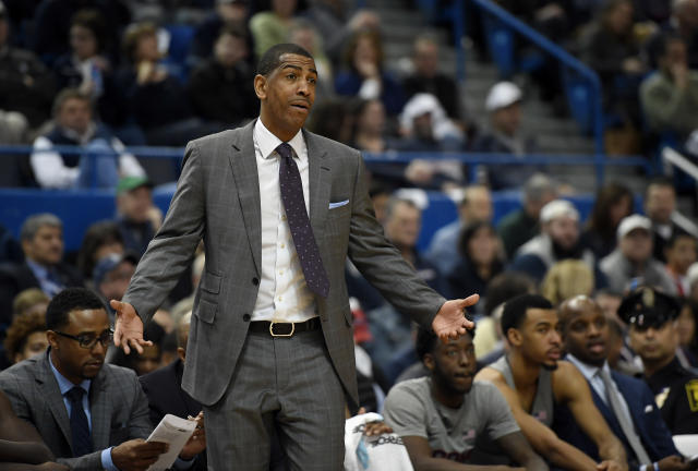 Connecticut head coach Kevin Ollie gestures during the first half of an NCAA college basketball game, Saturday, Jan. 20, 2018, in Hartford, Conn. (AP Photo/Jessica Hill)