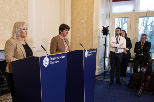 First Minster Arlene Foster (second from left) and Deputy First Minister Michelle O'Neill (left) hold a press conference at Stormont Castle, Belfast. (PA)