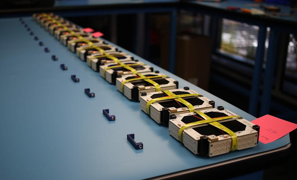 Swarm's tiny satellites lined up before launch.