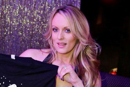 FILE PHOTO: Adult-film actress Stephanie Clifford, also known as Stormy Daniels, poses for pictures at the end of her striptease show in Gossip Gentleman club in Long Island, New York, U.S., February 23, 2018. REUTERS/Eduardo Munoz/File photo