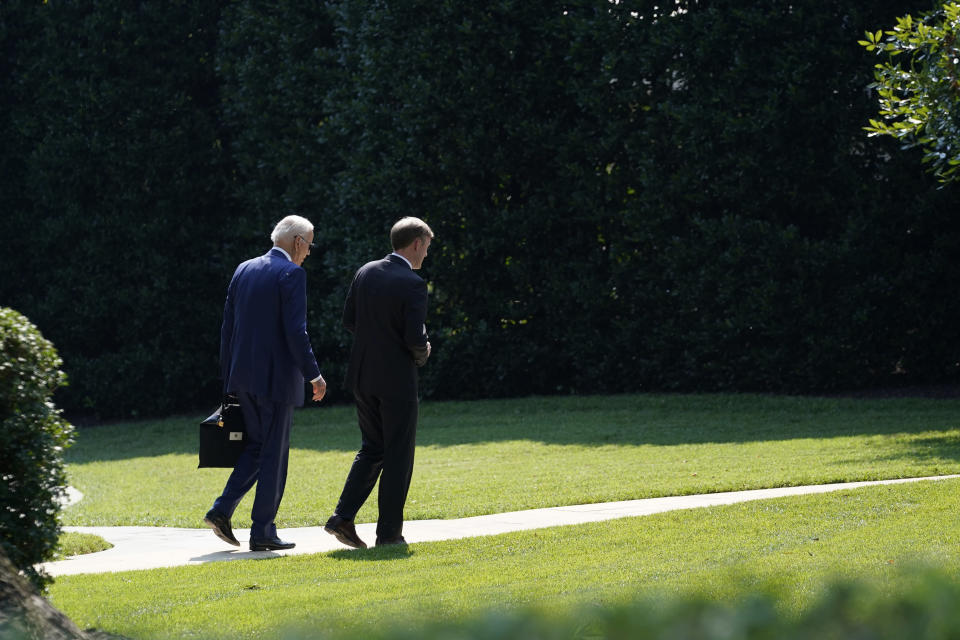 President Joe Biden, left, walks back to the Oval Office with National Security Adviser Jake Sullivan, right, at the White House in Washington, Tuesday, July 27, 2021. They were returning from a visit to the Office of the Director of National Intelligence in McLean, Virginia. (AP Photo/Susan Walsh)