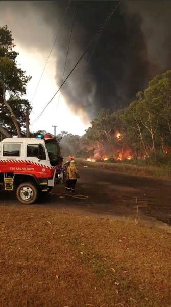 Social media video grab of firefighters responding to bushfires in Charmhaven