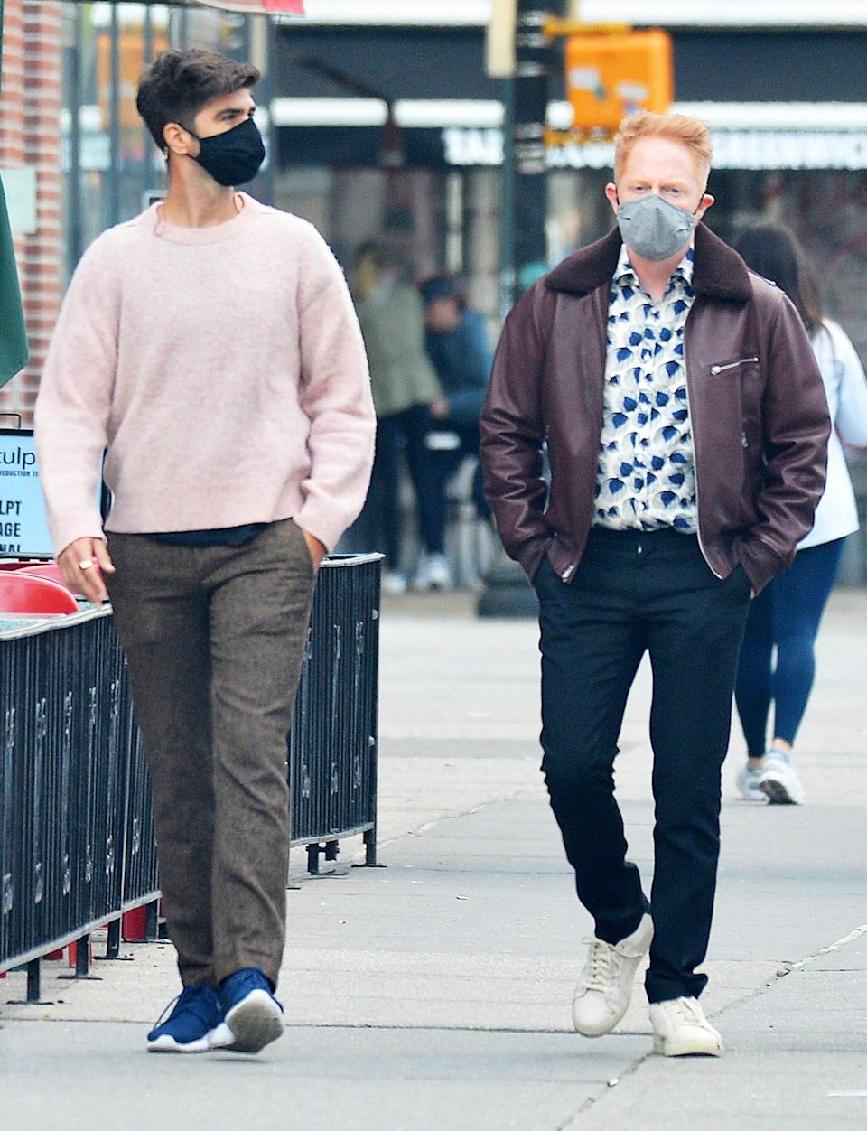 <p>Justin Mikita and Jesse Tyler Ferguson take a walk in N.Y.C. together on Wednesday. </p>