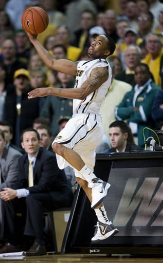 Missouri's Marcus Denmon saves a ball from going out-of-bounds during the second half of an NCAA college basketball game against Baylor Saturday, Feb. 11, 2012, in Columbia, Mo. Missouri won the game 72-57. (AP Photo/L.G. Patterson)