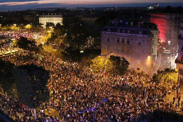 <p>People celebrate France's victory on the Champs Elysee in Paris on July 10, 2018, after the final whistle of the Russia 2018 World Cup semi-final football match between France and Belgium. (Photo by ZAKARIA ABDELKAFI / AFP) </p>