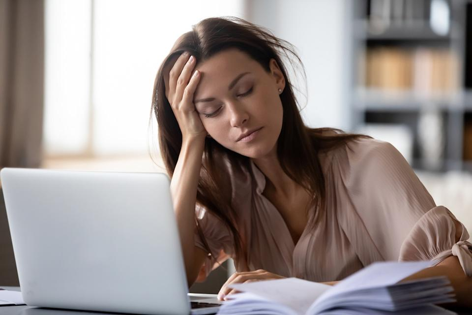 Tired millennial girl student sit at desk fall asleep studying late hours at laptop at home, exhausted young woman take nap sleep at workplace working on computer, exhaustion, fatigue concept