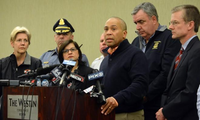 Massachusetts Gov. Deval Patrick is joined by FBI Special Agent Richard DesLauriers (far right) during a press conference on April 15.