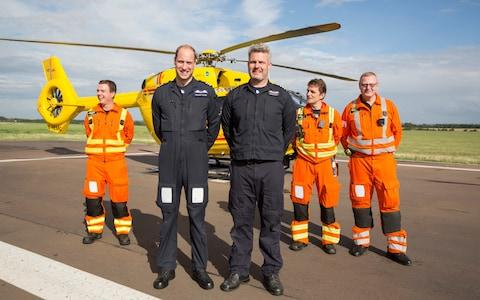 Prince William with the East Anglian Air Ambulance crew - Credit: Heathcliff O'Malley