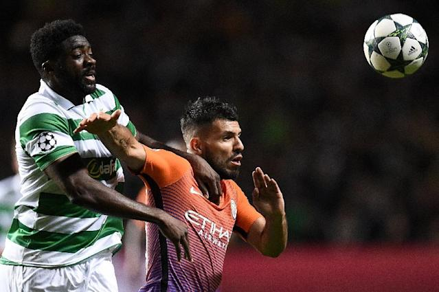 Celtic's Kolo Toure (L) vies with Manchester City's Sergio Aguero during the UEFA Champions League Group C match (AFP Photo/Oli Scarff)