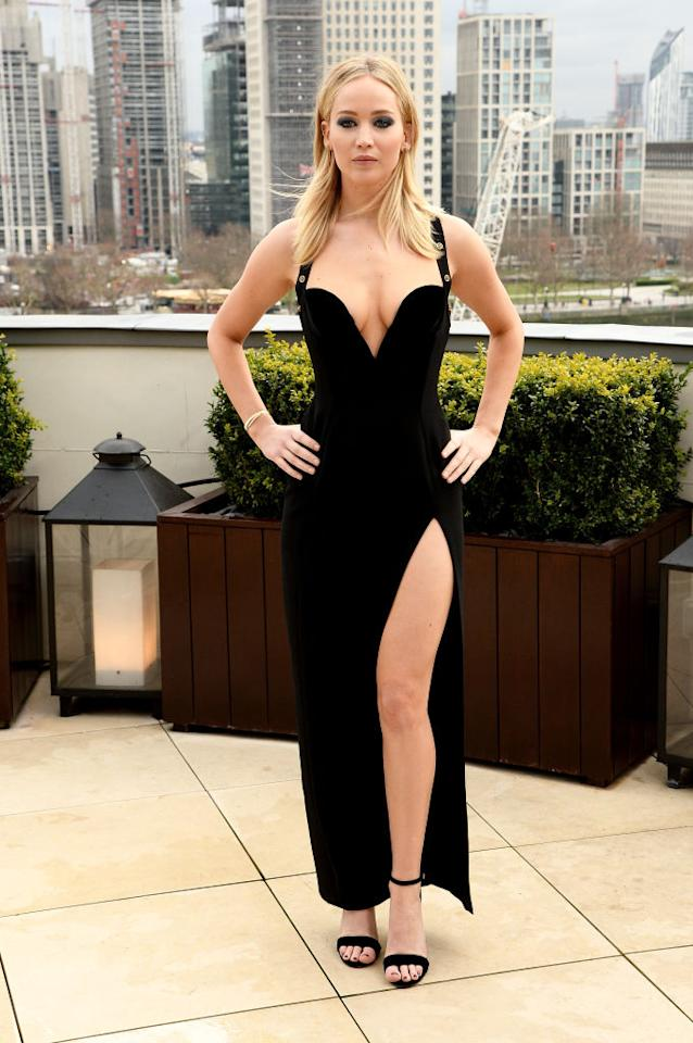 <p>Lawrence was criticized for wearing the sleeveless Versace dress in cold London weather. (Photo: Getty Images) </p>