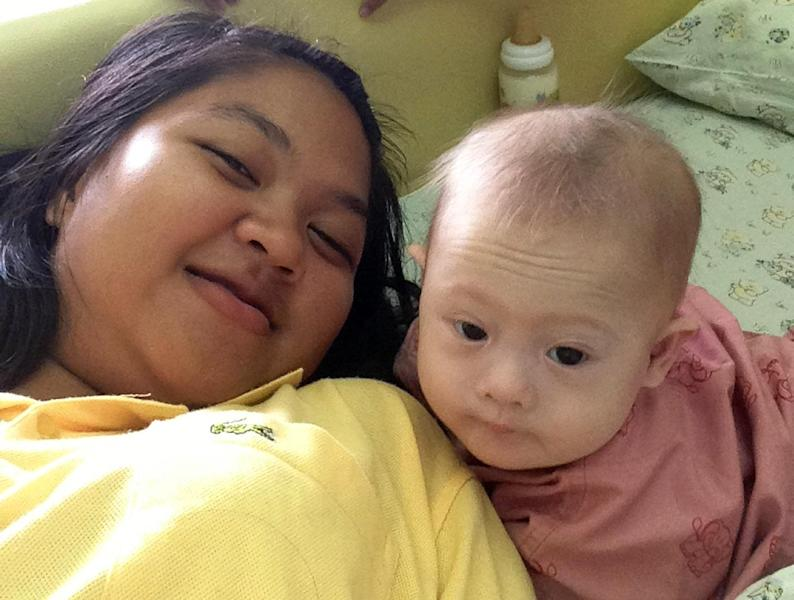 Undated photo shows Thai surrogate mother Pattaramon Chanbua posing for a photo with her baby Gammy, born with Down Syndrome, at the Sriracha district in Thailand's Chonburi province (AFP Photo/Pattaramon Chanbua)
