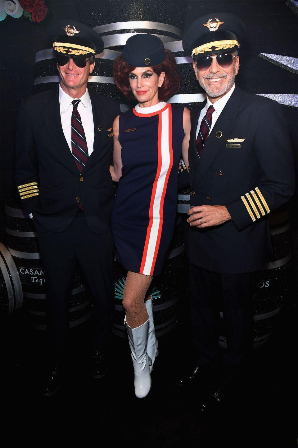 <p>Rande Gerber, Cindy Crawford, and George Clooney as retro pilots and a flight attendant.</p>