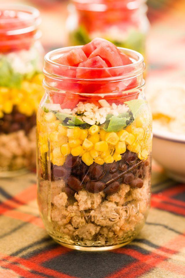 """<p>Layers of turkey mince, black beans, corn, spring onions, cheese, and tomatoes is lunchtime goals. </p><p>Get the <a href=""""https://www.delish.com/uk/cooking/recipes/a29891198/taco-salad-in-a-jar-recipe/"""" rel=""""nofollow noopener"""" target=""""_blank"""" data-ylk=""""slk:Taco Salad Jar"""" class=""""link rapid-noclick-resp"""">Taco Salad Jar</a> recipe. </p>"""
