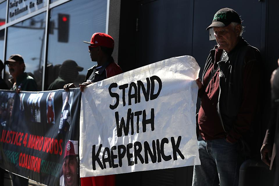 Protesters demonstrate in support of San Francisco 49ers quarterback Colin Kaepernick outside of the San Francisco Police Officers Association offices on August 31, 2016 in San Francisco. (Getty)