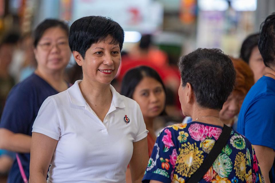 Tanjong Pagar GRC MP Indranee Rajah speaking to a patron at the Tiong Bahru Food Centre on Sunday (29 September). (PHOTO: Dhany Osman / Yahoo News Singapore)