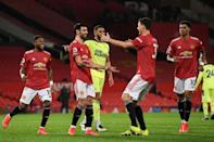 Spot on: Bruno Fernandes (2nd left)sealed Manchester United's win with his 22nd goal of the season