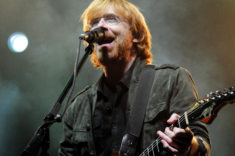 Phish front man Trey Anastasio performs during their benefit concert at the Champlain Valley Exposition in Essex Junction, Vt, on Wednesday, Sept. 14, 2011.  Proceeds will benefit the people of Vermont impacted by Hurricane Irene.    The band, which first began playing in Burlington in the early 1980s, hasn't held a concert in the state since 2004, when members put on a show to celebrate their break-up. AP Photo/Alison Redlich)