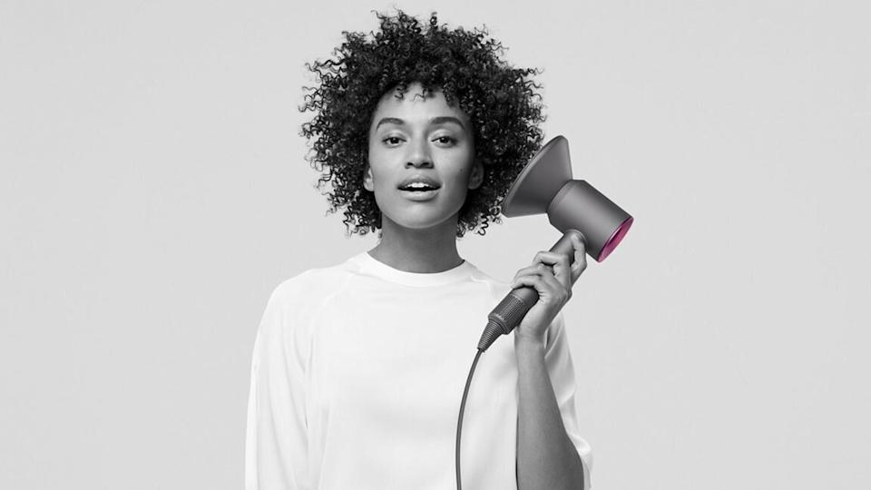 "<a href=""https://fave.co/2KZ93T5"" target=""_blank"" rel=""noopener noreferrer"">Dyson's Supersonic hair dryer</a> has reached <a href=""https://www.cnn.com/2020/11/19/cnn-underscored/dyson-supersonic-hair-dryer-review/index.html"" target=""_blank"" rel=""noopener noreferrer"">legendary status</a> on the internet. The dryer is supposed to help avoid "" extreme heat damage"" and dry your hair <i>fast</i>. It's almost never marked down (seriously, you have to <a href=""https://people.com/beauty/dyson-supersonic-hair-dryer-airwrap-straightener-sephora-sale/"" target=""_blank"" rel=""noopener noreferrer"">wait for a Sephora sale</a>). Even on Black Friday, you couldn't count on getting a discount. But what you could count on was two free gifts (including a stand and brush) when you purchased it. And you can still get those gifts when you <a href=""https://fave.co/2KZ93T5"" target=""_blank"" rel=""noopener noreferrer"">buy the dryer at Dyson</a>. <a href=""https://fave.co/2KZ93T5"" target=""_blank"" rel=""noopener noreferrer"">Find it for $400 at Dyson.</a>"